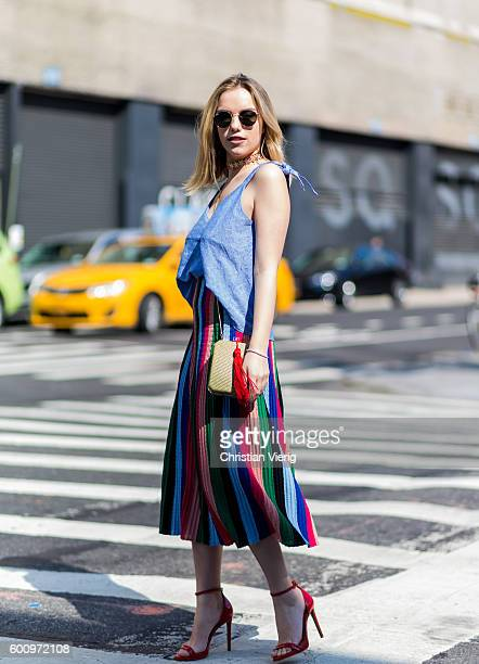 A guest wearing a red green blue skirt and heels outside Noon By Noor on September 8 2016 in New York City