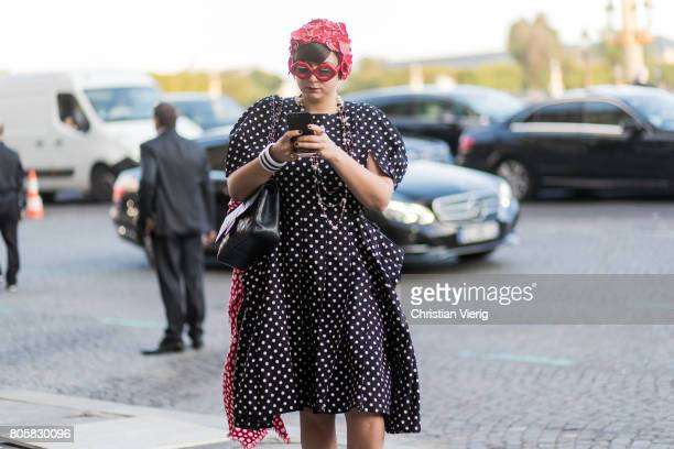A guest wearing a red hat outside Miu Miu Cruise Collection during Paris Fashion Week Haute Couture Fall/Winter 20172018 Day One on July 2 2017 in...