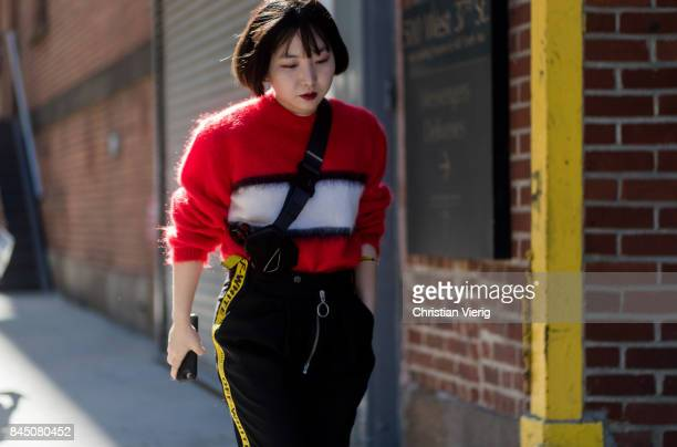 A guest wearing a red knit Off White pants seen in the streets of Manhattan outside SelfPortrait during New York Fashion Week on September 9 2017 in...