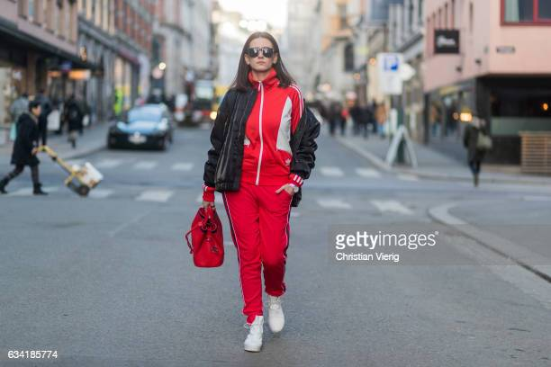 A guest wearing a red track suit red bag and black jacket on February 7 2017 in Oslo Norway