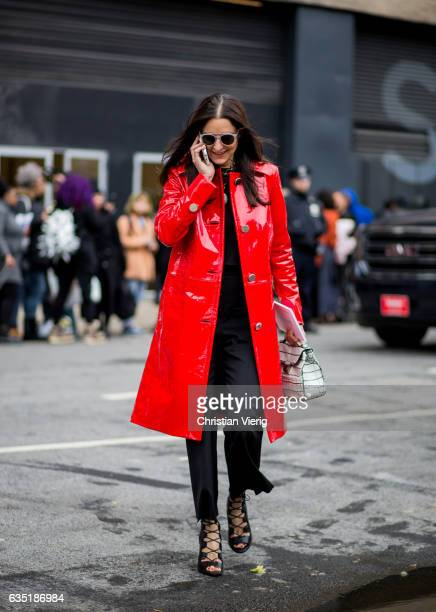 A guest wearing a red vinyl coat outside Proenza Schouler on February 13 2017 in New York City