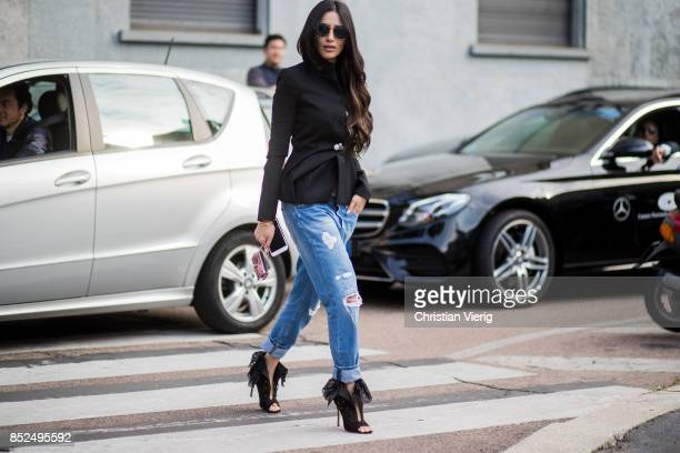 A guest wearing a ripped denim jeans is seen outside Bottega Veneta during Milan Fashion Week Spring/Summer 2018 on September 23 2017 in Milan Italy