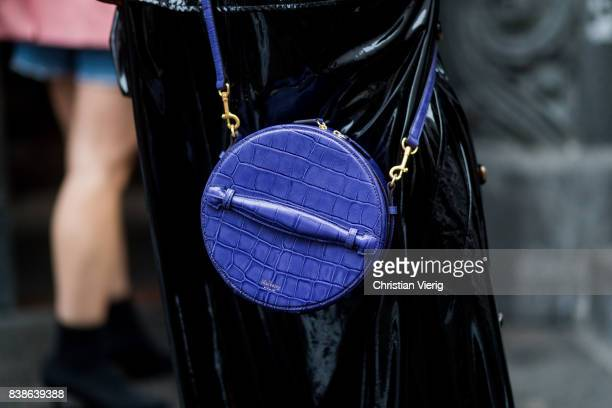 A guest wearing a round Mulberry bag outside Bik Bok Runway Award on August 24 2017 in Oslo Norway
