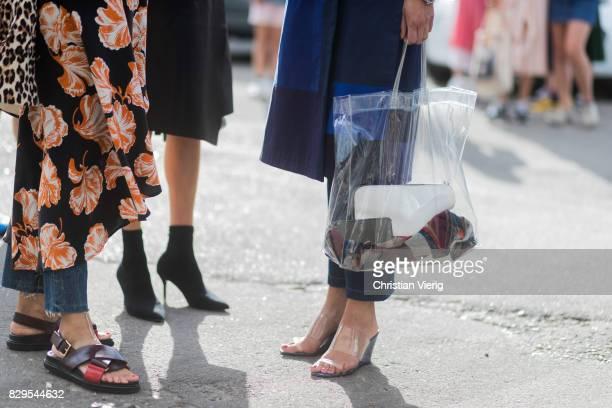A guest wearing a sheer bag outside Ganni on August 10 2017 in Copenhagen Denmark