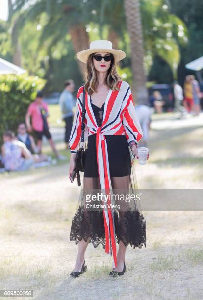 A guest wearing a sheer skirt hat during day 3 of the 2017 Coachella Valley Music Arts Festival Weekend 1 on April 16 2017 in Indio California
