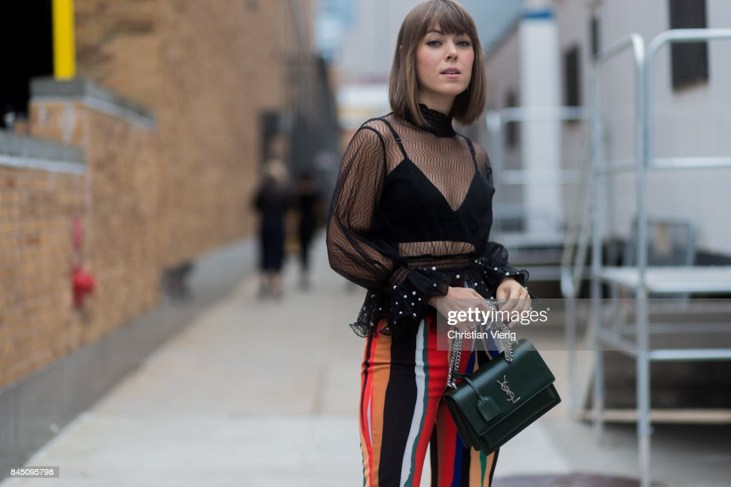 A guest wearing a sheer top, YSL bag seen in the streets of Manhattan outside Jonathan Simkhai during New York Fashion Week on September 9, 2017 in New York City.