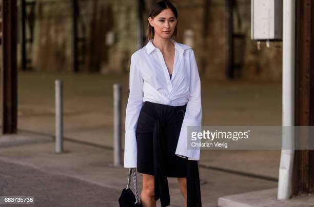 A guest wearing a shirt with wide sleeves black skirt at day 3 during MercedesBenz Fashion Week Resort 18 Collections at Carriageworks on May 16 2017...