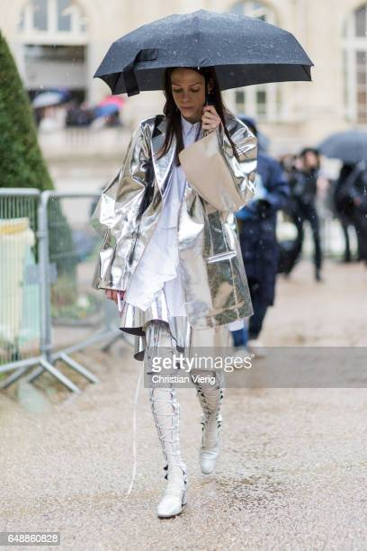 A guest wearing a silver coat outside Sacai on March 6 2017 in Paris France