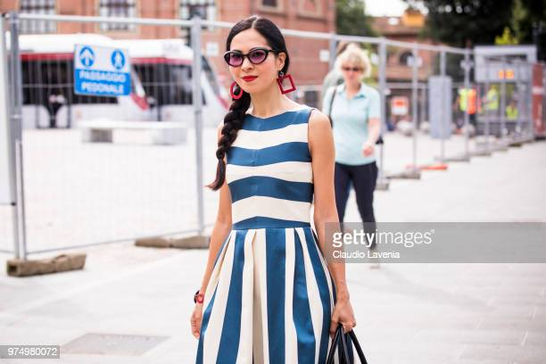 A guest wearing a striped dress is seen during the 94th Pitti Immagine Uomo at Fortezza Da Basso on June 14 2018 in Florence Italy