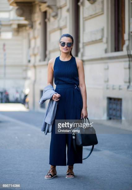 A guest wearing a striped jumpsuit is seen during Pitti Immagine Uomo 92 at Fortezza Da Basso on June 13 2017 in Florence Italy