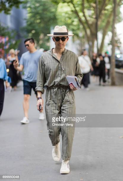A guest wearing a striped jumpsuit outside Issey Miyake during Paris Fashion Week Menswear Spring/Summer 2018 on June 22 2017 in Paris France