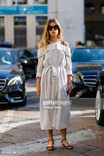 A guest wearing a striped off shoulder dress outside Ferragamo during Milan Fashion Week Spring/Summer 2017 on September 25 2016 in Milan Italy