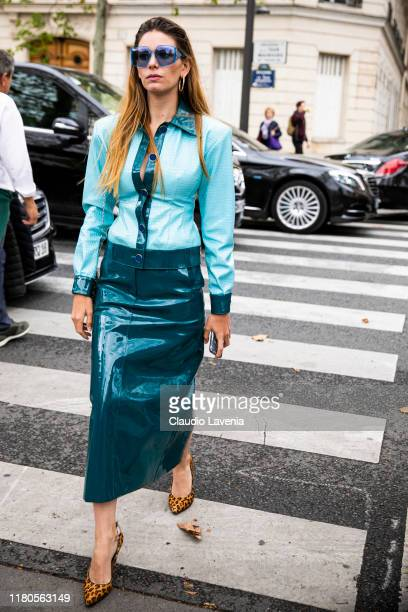 A guest wearing a teal blue shirt green midi skirt and leopard print heels is seen outside the Valentino show during Paris Fashion Week Womenswear...