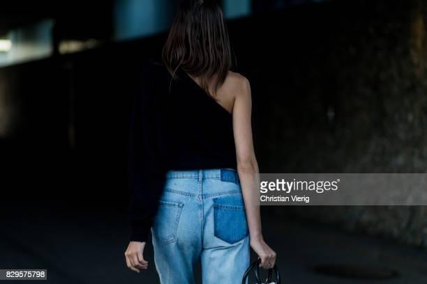 A guest wearing a two tone denim jeans outside Saks Potts on August 10 2017 in Copenhagen Denmark