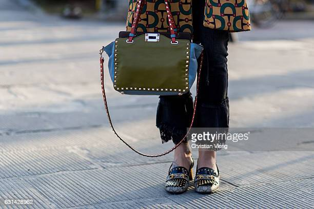 Guest wearing a Valentino bag on January 10, 2017 in Florence, Italy.