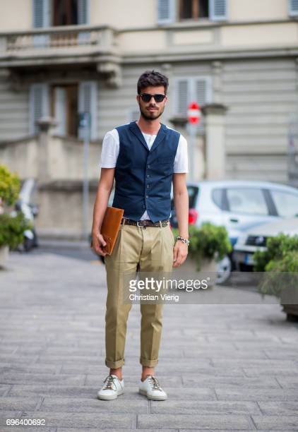 A guest wearing a vest clutch beige pants is seen during Pitti Immagine Uomo 92 at Fortezza Da Basso on June 15 2017 in Florence Italy