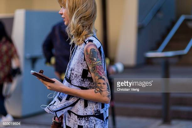 A guest wearing a white black sleeveless dress eith graphic print and tattoos at MercedesBenz Fashion Week Resort 17 Collections at Carriageworks on...