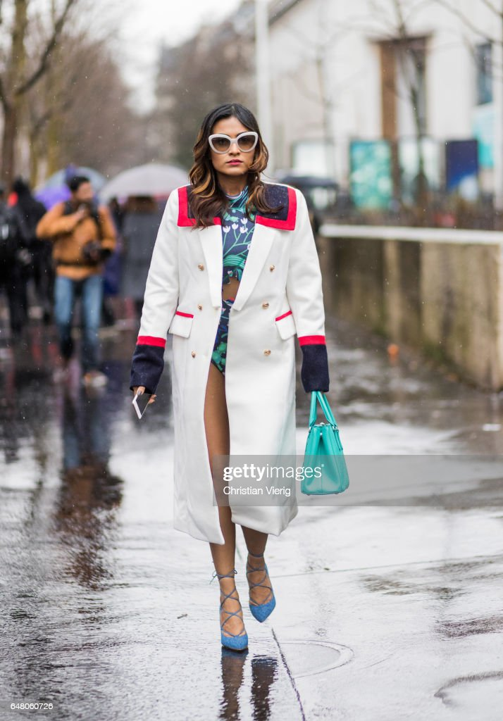 A guest wearing a white coat outside Mugler on March 4, 2017 in Paris, France.