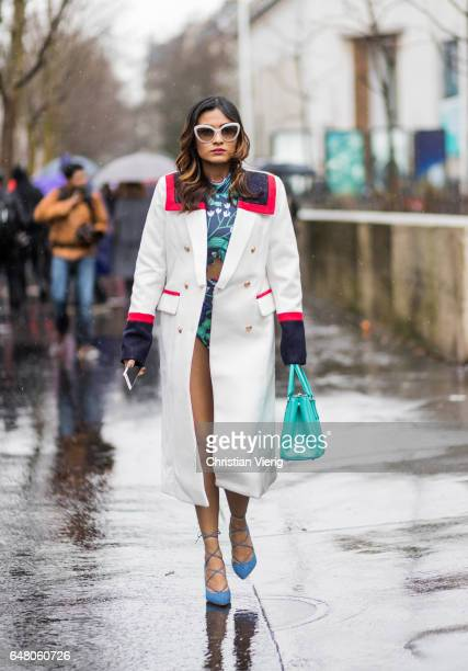 A guest wearing a white coat outside Mugler on March 4 2017 in Paris France