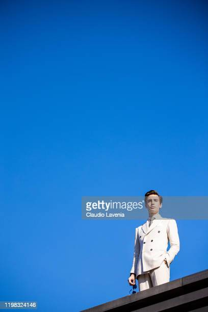 A guest wearing a white double breasted jacket is seen at Fortezza Da Basso on January 08 2020 in Florence Italy