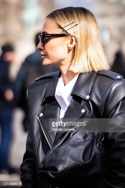 Guest, wearing a white shirt, black Bottega Veneta bag and black leather jacket, is seen outside Miu Miu, during Paris Fashion Week - Womenswear...
