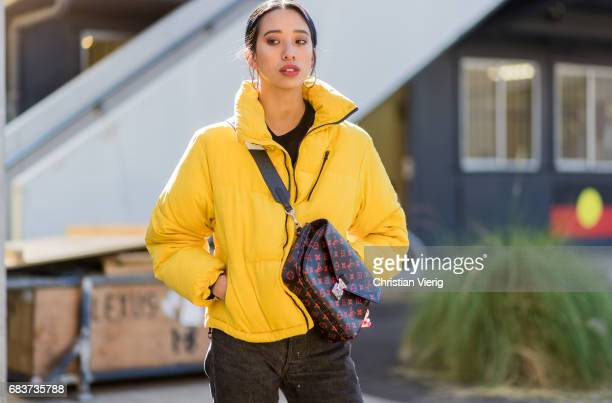 A guest wearing a yellow jacket Louis Vuitton bag at day 3 during MercedesBenz Fashion Week Resort 18 Collections at Carriageworks on May 16 2017 in...