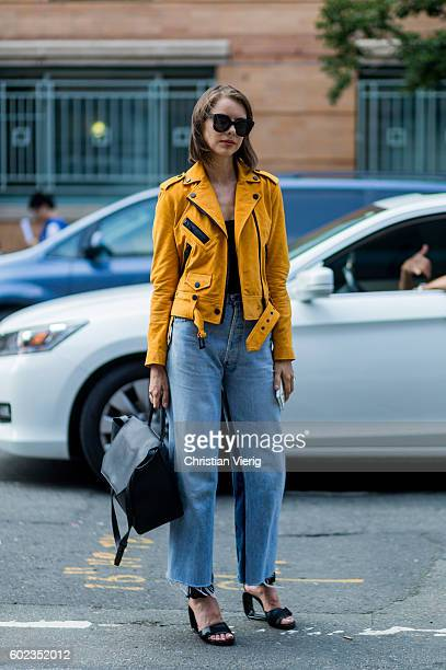 A guest wearing a yellow leather jacket outside Tibi on September 10 2016 in New York City