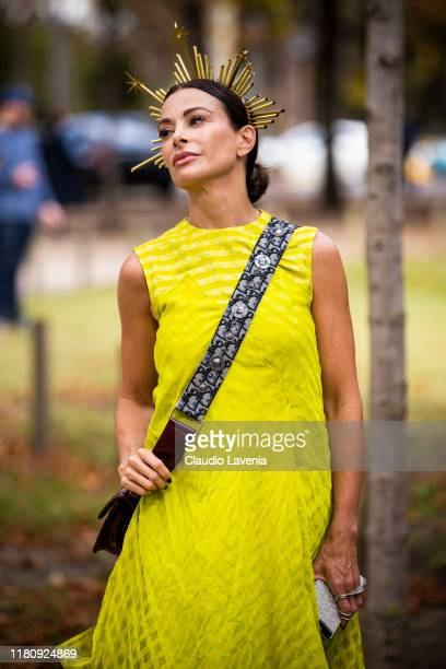 Guest, wearing a yellow maxi dress and Dior bag, is seen outside the Elie Saab show during Paris Fashion Week - Womenswear Spring Summer 2020 on...