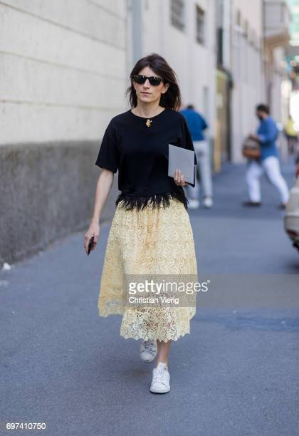 A guest wearing a yellow sheer skirt is seen outside MSGM during Milan Men's Fashion Week Spring/Summer 2018 on June 18 2017 in Milan Italy