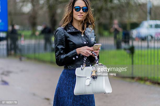 A guest wearing ablack leather jacket seen outside Pringle of Scotland during London Fashion Week Autumn/Winter 2016/17 on February 22 2016 in London...