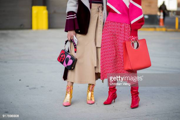 A guest wearing Aigner bag and a guest wearing a red Ferragamo bag seen outside 31 Phillip Lim on February 12 2018 in New York City