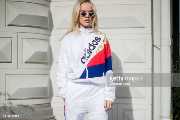 A guest wearing an Adidas track suit outside By Malina on August 30 2017 in Stockholm Sweden