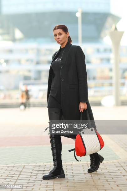 Guest wearing an all black look with black thigh high suede and leather boots over black leather pants with a black sweatshirt and a black woolen...