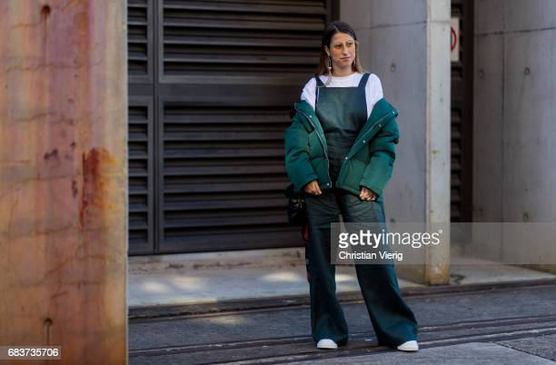 A guest wearing an olive jumpsuit white tshirt green jacket at day 3 during MercedesBenz Fashion Week Resort 18 Collections at Carriageworks on May...
