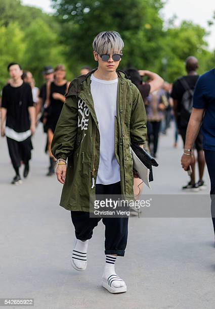 A guest wearing an olive parka outside Dries van Noten during the Paris Fashion Week Menswear Spring/Summer 2017 on June 23 2016 in Paris France