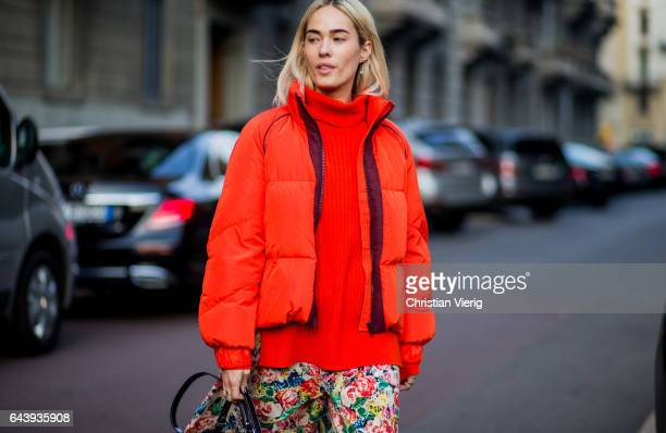 A guest wearing an orange down feather jacket knit outside Alberta Ferretti on February 22 2017 in Milan Italy