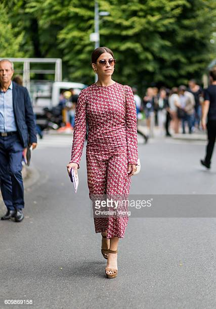 A guest wearing an overall outside Fendi during Milan Fashion Week Spring/Summer 2017 on September 22 2016 in Milan Italy