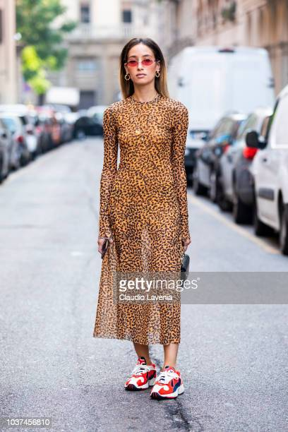 A guest wearing animalier dress and Adidas sneakers is seen before the Blumarine show during Milan Fashion Week Spring/Summer 2019 on September 21...