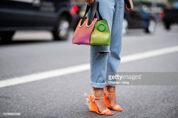 A guest wearing bag and orange heels with flame application is seen outside Kate Spade during New York Fashion Week Spring/Summer 2019 on September 7...