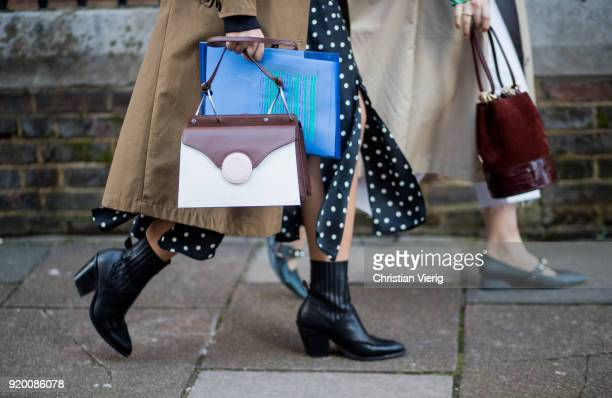 A guest wearing bag black ankle boots seen outside Temperley London during London Fashion Week February 2018 on February 18 2018 in London England