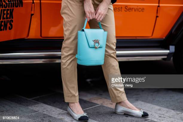 A guest wearing bag Chanel slippers is seen during London Fashion Week Men's June 2018 on June 9 2018 in London England