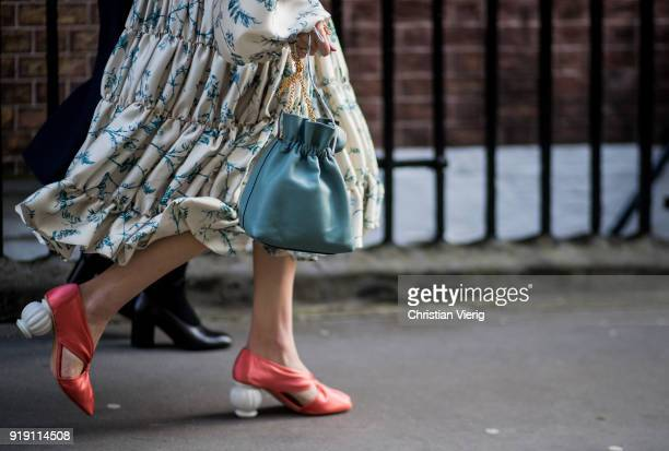A guest wearing bag heels seen outside Mulberry during London Fashion Week February 2018 on February 16 2018 in London England