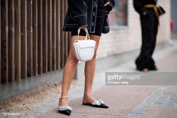 A guest wearing bag is seen outside Stine Goya during the Copenhagen Fashion Week Spring/Summer 2019 on August 8 2018 in Copenhagen Denmark