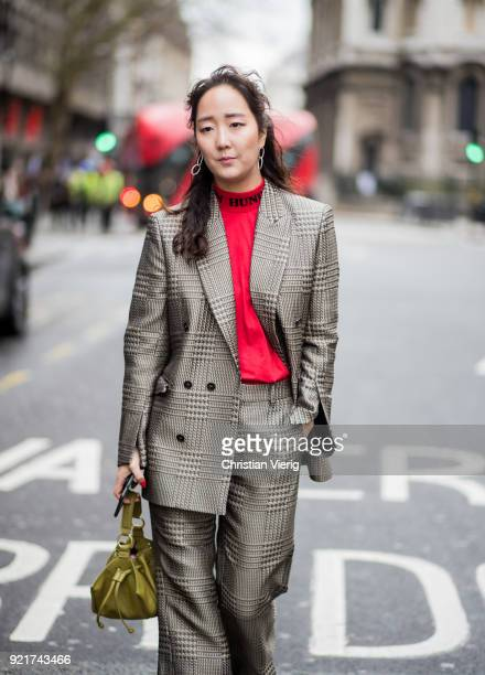 A guest wearing bag plaid suit seen outside Eudon Choi during London Fashion Week February 2018 on February 20 2018 in London England