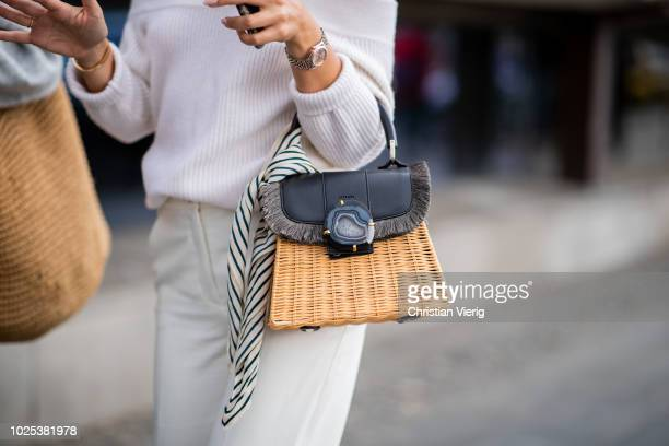 A guest wearing basket bag during Stockholm Runway SS19 on August 30 2018 in Stockholm Sweden