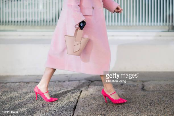 A guest wearing basket bag heels pink wool coat during MercedesBenz Fashion Week Resort 19 Collections at Icebergs Dining Room on May 17 2018 in...