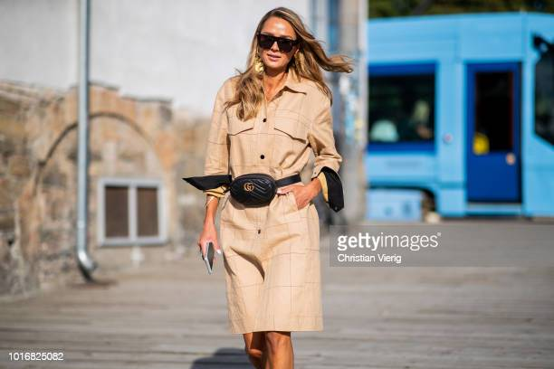 A guest wearing beige dress Gucci belt bag seen outside byTiMo during Oslo Runway SS19 on August 14 2018 in Oslo Norway