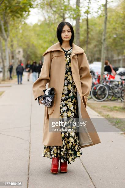 Guest wearing beige long coat and red block heeled boots outside Loewe during Paris Fashion Week - Womenswear Spring Summer 2020 on September 27,...