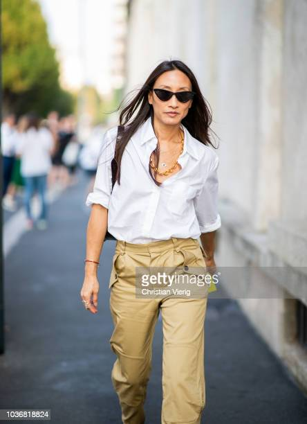 A guest wearing beige pants white button shirt is seen outside Prada during Milan Fashion Week Spring/Summer 2019 on September 20 2018 in Milan Italy