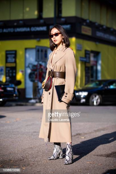 A guest wearing beige trench coat with brown belt and animalier heels boots is seen before the Marni show during Milan Fashion Week Spring/Summer...